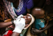 South Sudanese baby is given polio drops